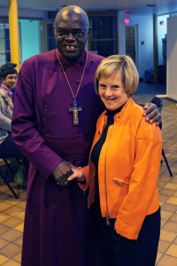 Archbishop Sentamu shares a hug and handshake with Tanya Ponich.